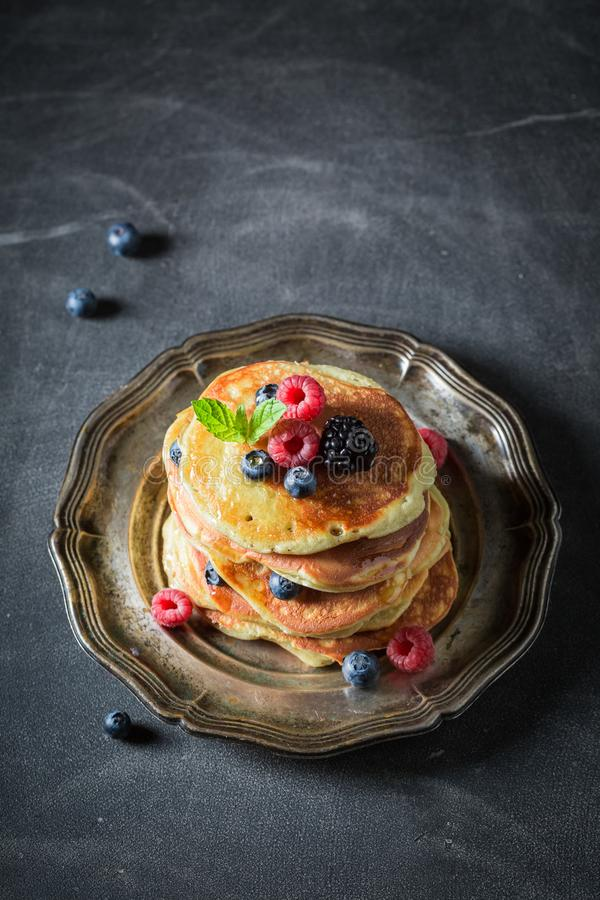 American pancakes with maple syrup and berries royalty free stock photos
