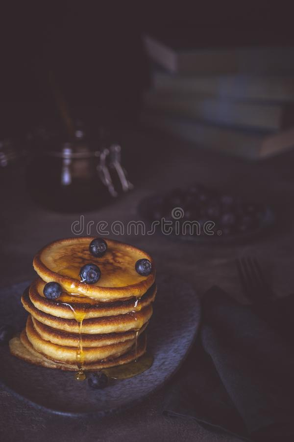 American Pancakes with Organic Berries and Maple Syrup on Dark Background. Classic Homemade Breakfast. royalty free stock image