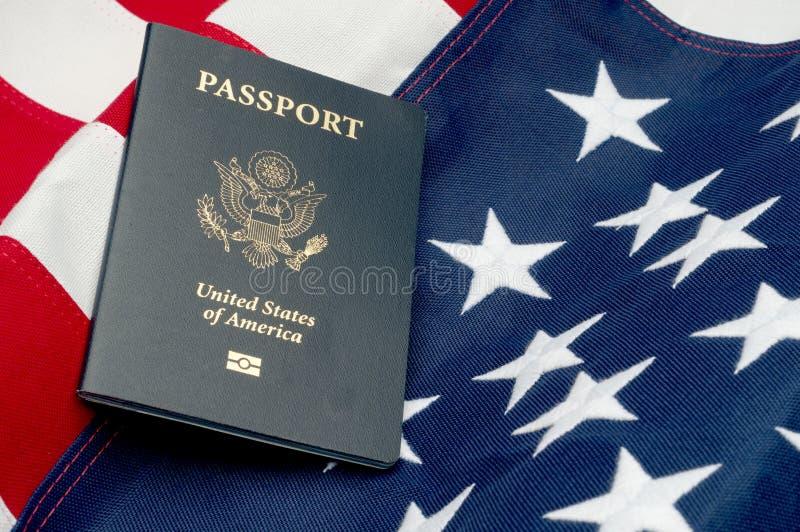 An American passport on an American flag. A horizontal image of an American passport on an American flag stock photo