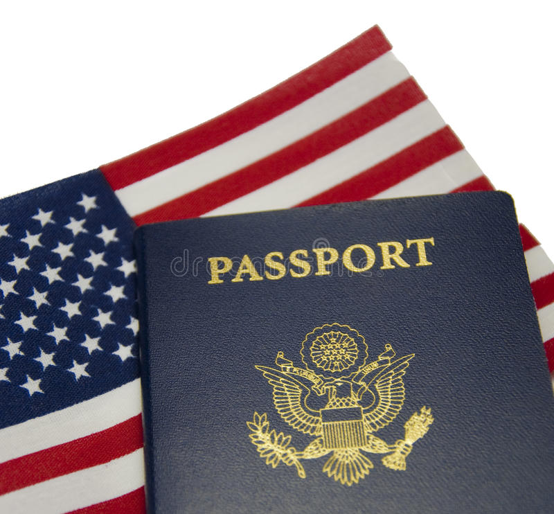American Passport & Flag. An american passport in front of a American flag royalty free stock images
