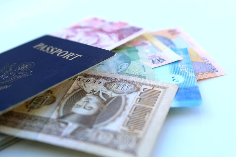 American passport and international currencies. On a white background royalty free stock photography