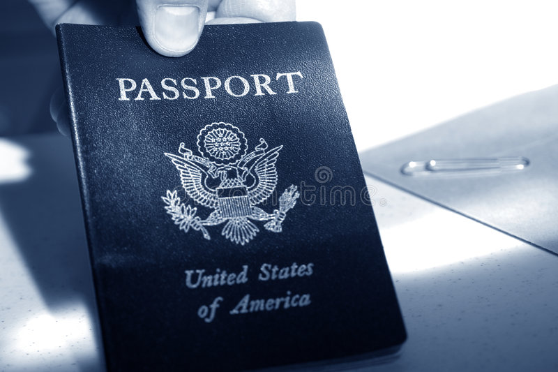 American Passport in Traveler Hand at Immigration stock image