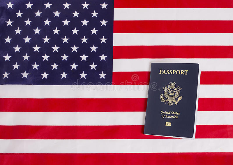 American Passport With USA Flag. American passport with chip and USA flag royalty free stock images