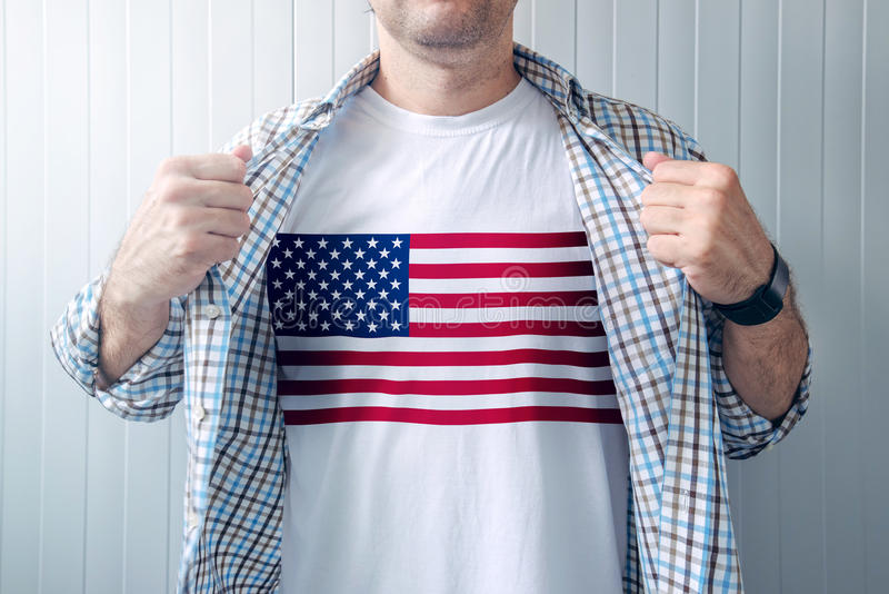 American patriot wearing white shirt with USA flag print. Adult male person supporting United States of America royalty free stock photo