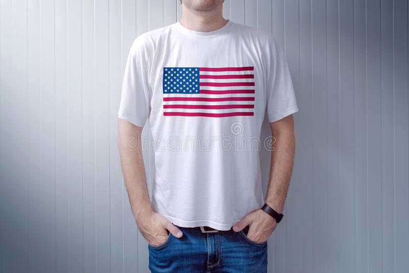 American patriot wearing white shirt with USA flag print. Adult male person supporting United States of America royalty free stock image