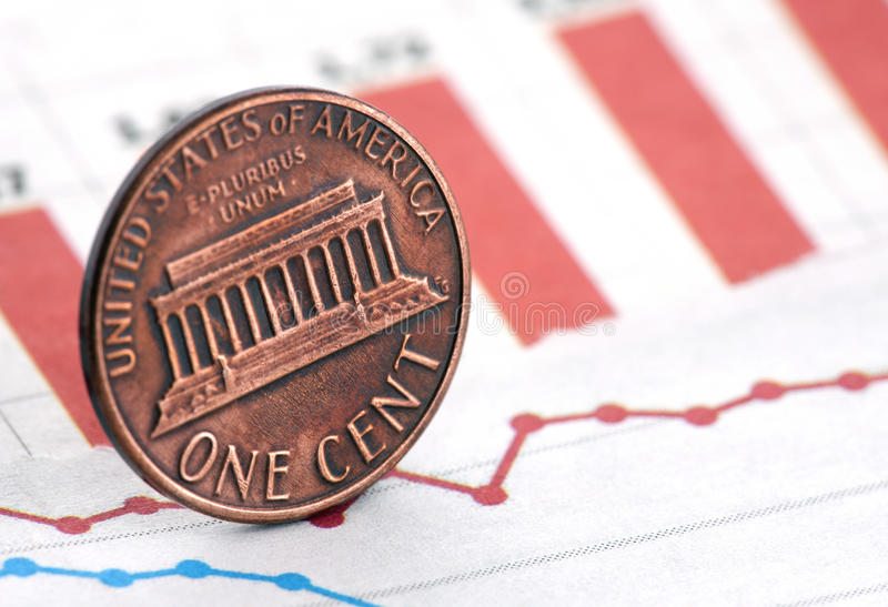 American penny on newspaper chart stock photos