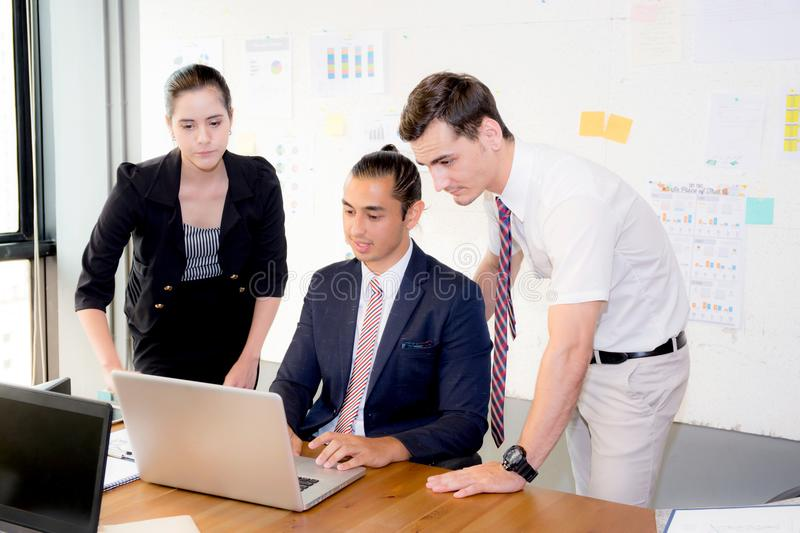 American people business team having using laptop during a meeting and presents. stock photography