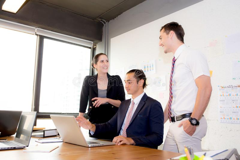 American people business team having using laptop during a meeting and presents. royalty free stock photos
