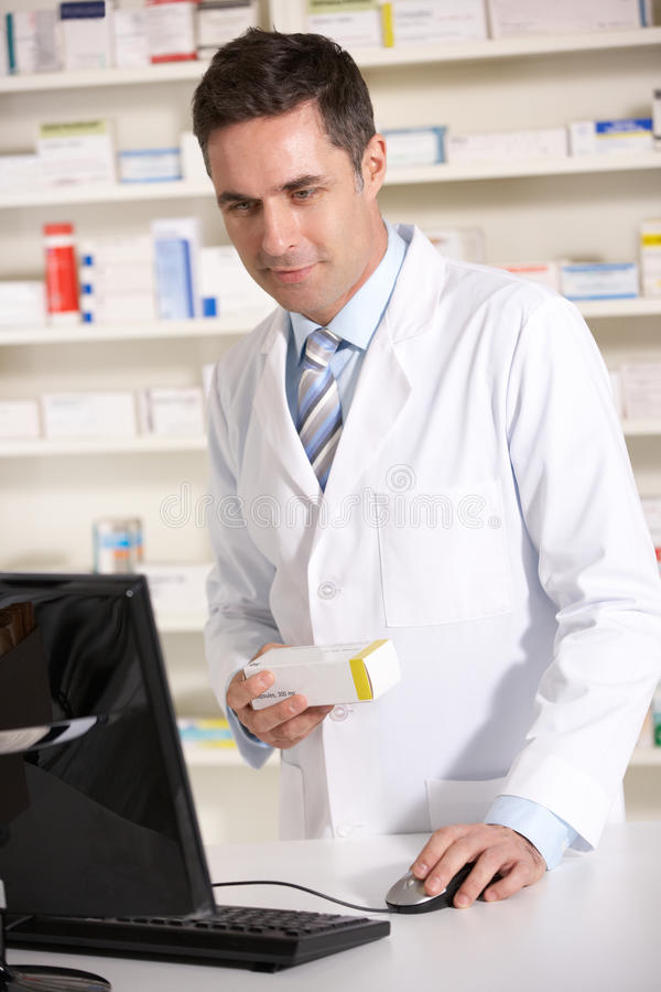 Download American Pharmacist Working On Computer Stock Photo - Image: 23958332