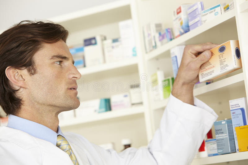 American pharmacist working in pharmacy royalty free stock photos
