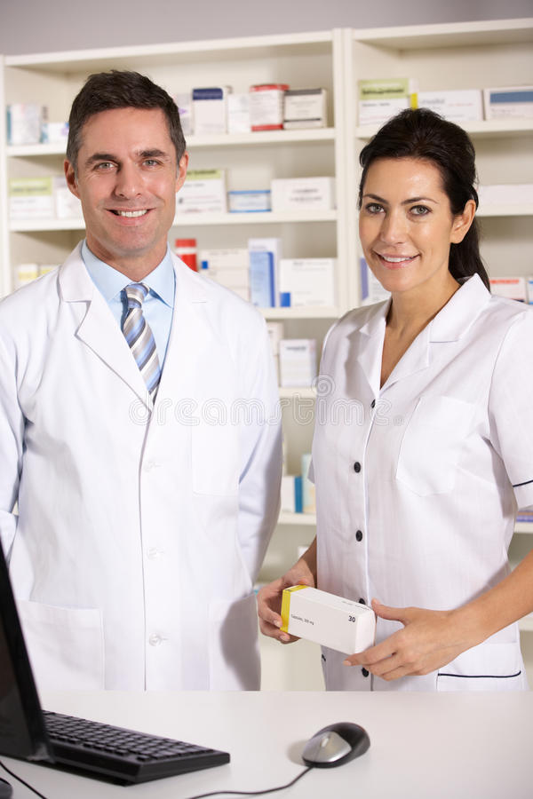 American pharmacists at work. Smiling at camera stock images
