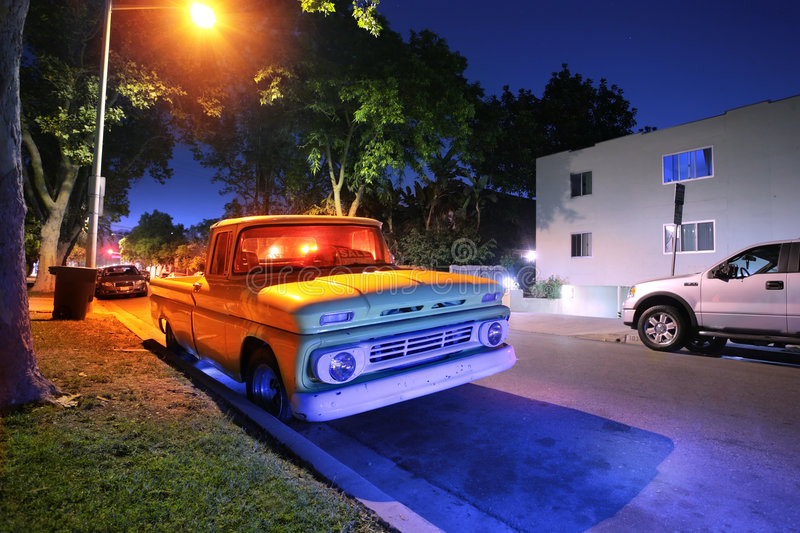 American pickup truck. Vintage American pickup truck at night on a street in Los Angeles, California, USA royalty free stock photos