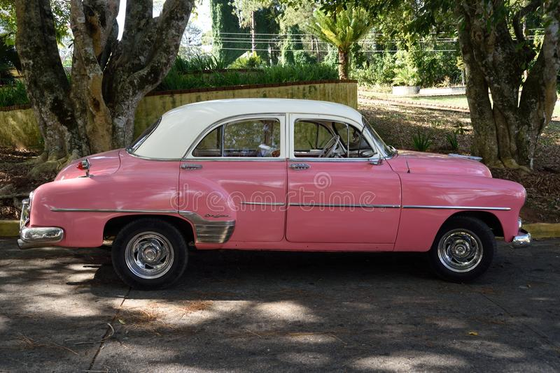 Pink car. American pink color classic car, very old but splendid looking. Trinidad. Cuba royalty free stock photos