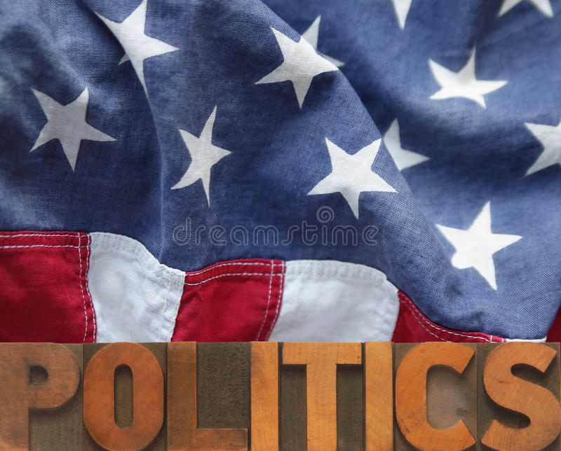 American politics. American flag with politics word in wood type royalty free stock photos
