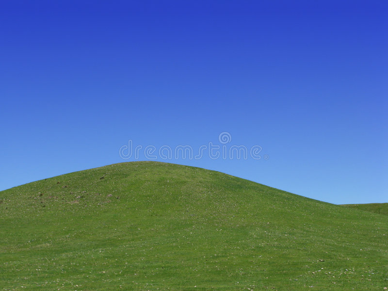 American Prairie Grass Hill over Blue Western Sky royalty free stock images