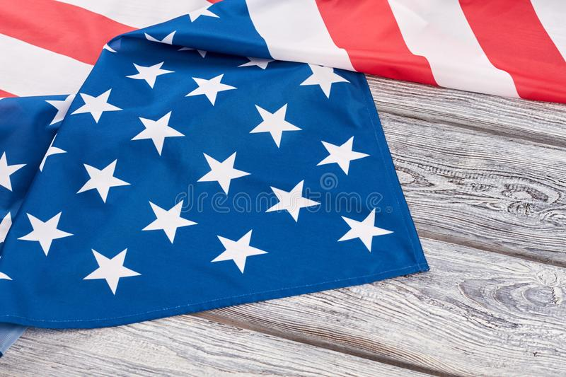 American pride United States flag. Crumpled flag of USA on vintage wooden boards with text space stock images