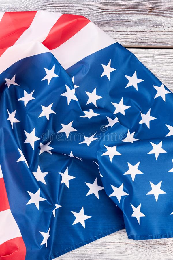 American pride United States flag. Satin American flag on old wooden boards, top view stock image