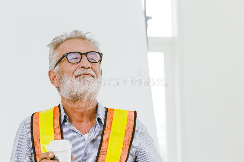 American professional worker senior engineer pleased for good work job done and ready for retirement concept. In working site stock image