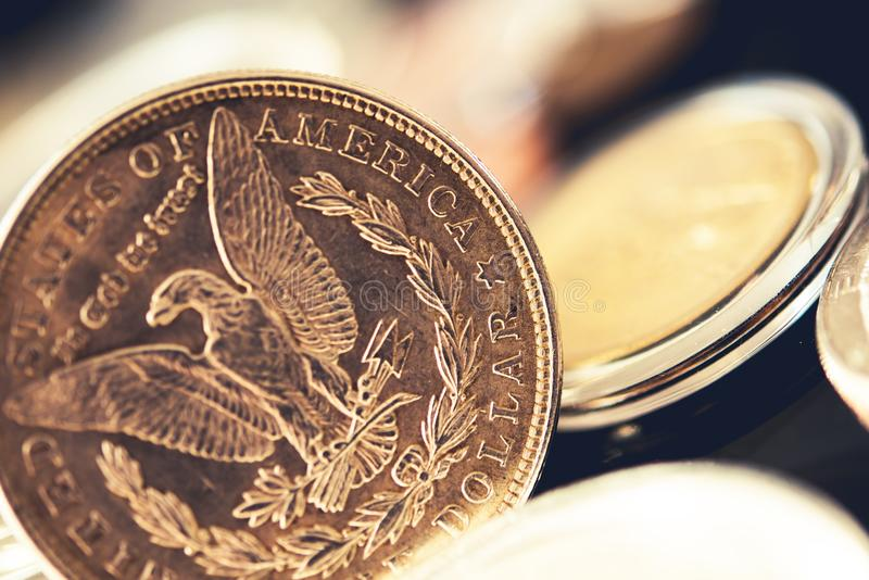 American Quarter Dollar Coin. And Other Collectible Coins in the Background royalty free stock image