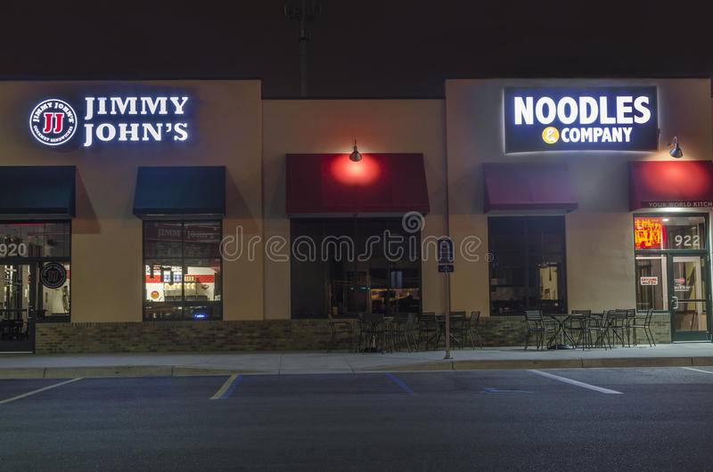 American Restaurant Chains In Commercial Area at Night. Moorhead, Minnesota, United States - July 18, 2015: Exterior of two restaurant chains, Jimmy John's and stock photo