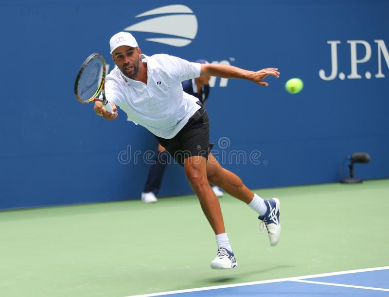 American retired professional tennis player James Blake in action during 2018 US Open exhibition match. NEW YORK - AUGUST 22, 2018: American retired professional royalty free stock images
