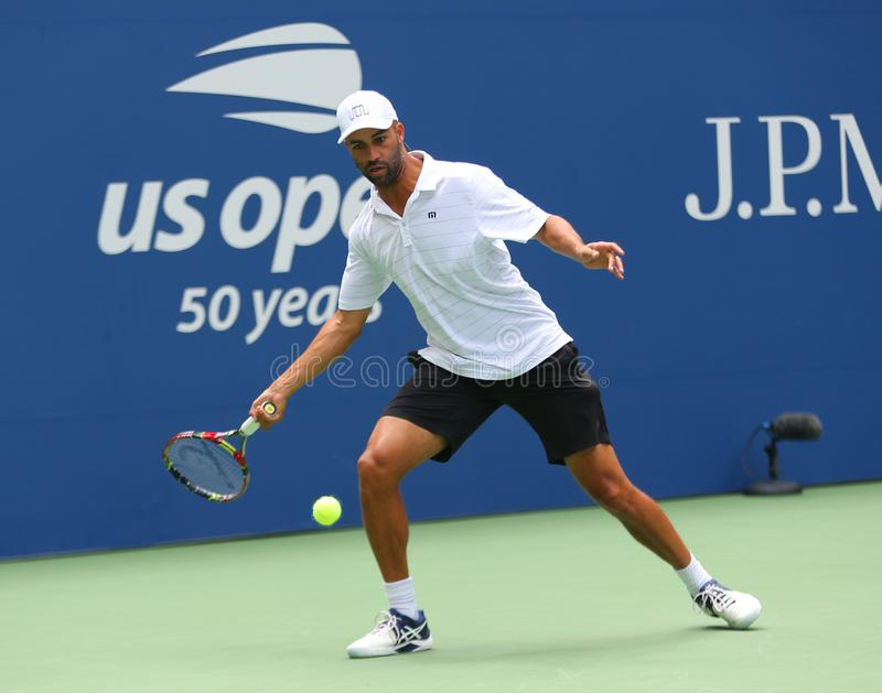 American retired professional tennis player James Blake in action during 2018 US Open exhibition match. NEW YORK - AUGUST 22, 2018: American retired professional stock photo