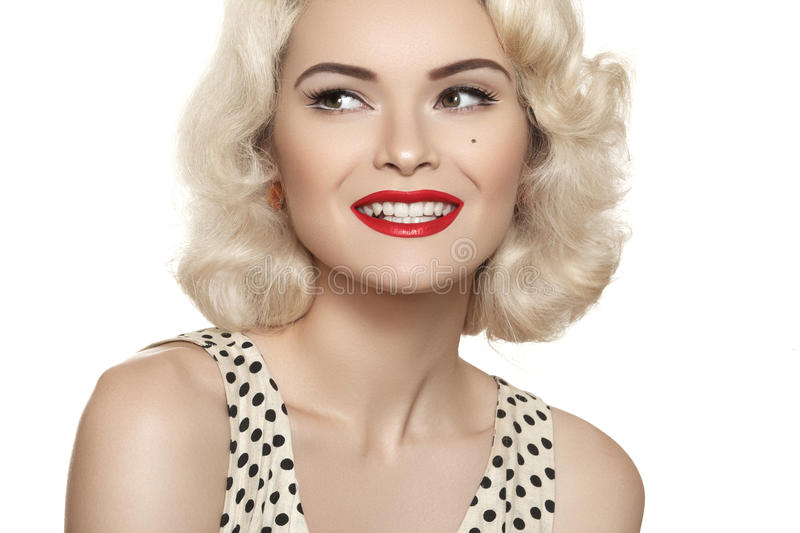 American retro style. Beautiful laughing woman model with old fashioned make-up, blond hair, happy smile royalty free stock photos