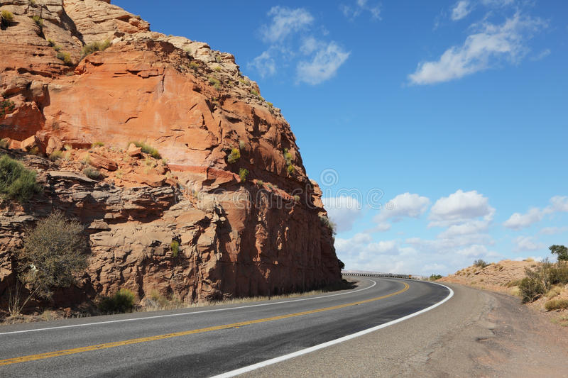 The American roads in the red rock desert royalty free stock photo