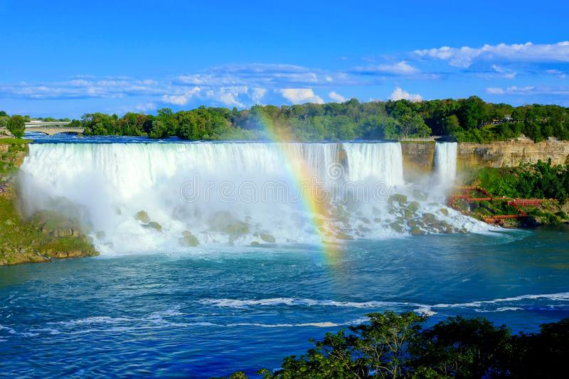 American side of Niagara Falls with beautiful rainbow stock images