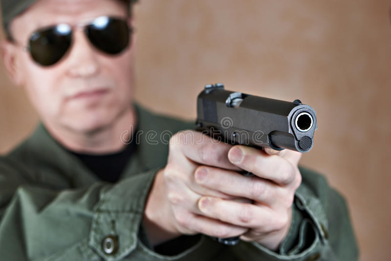 American soldier aiming a pistol. Colt royalty free stock photography