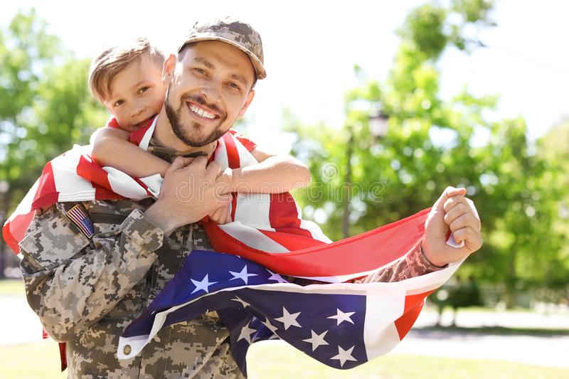 American soldier with his son outdoors. Military service stock images
