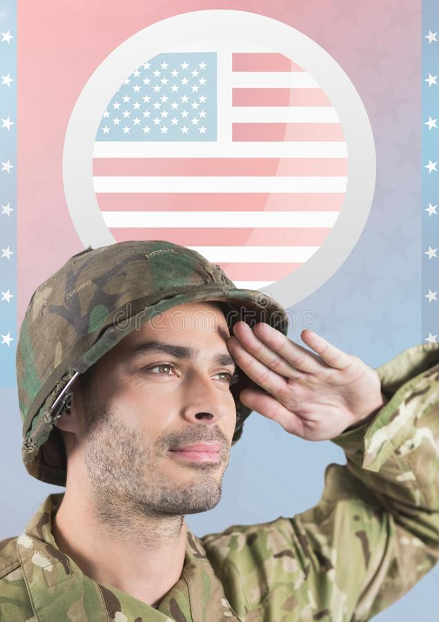 American soldier saluting against american flag stock photo
