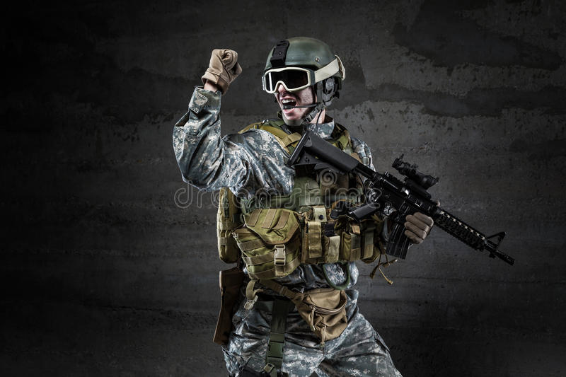 American Soldier shouting on dark background stock photography