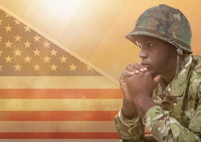 American Soldier thinking against american flag royalty free stock photo