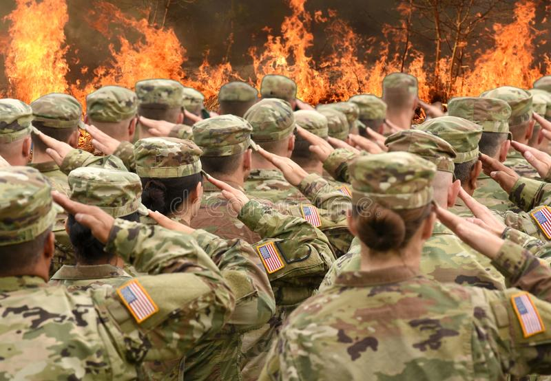 American soldiers saluting and fire in the front collage royalty free stock images