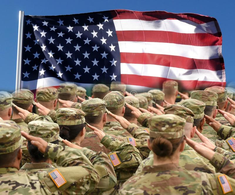 American Soldiers Saluting US Flag, patriotic concept stock photography