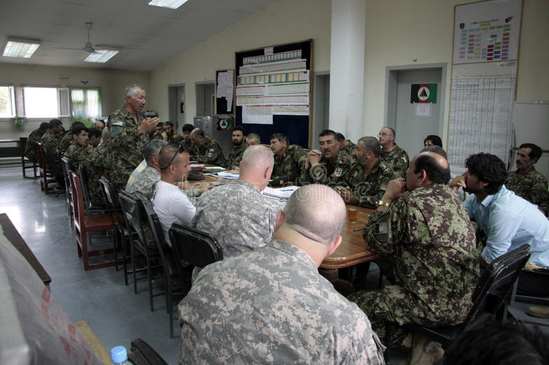 American Soldiers train Afghan Army. American Officers listen in while Afghan officers discuss the difficulties of sustaining the Afghan Army with supplies stock photography