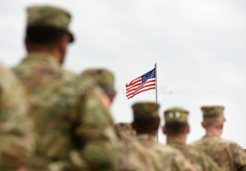 American Soldiers and US Flag. US troops stock photography