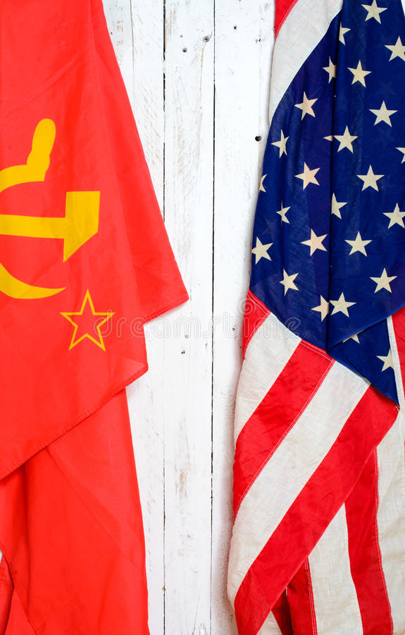 American and Soviet flag. On a white wall royalty free stock photos