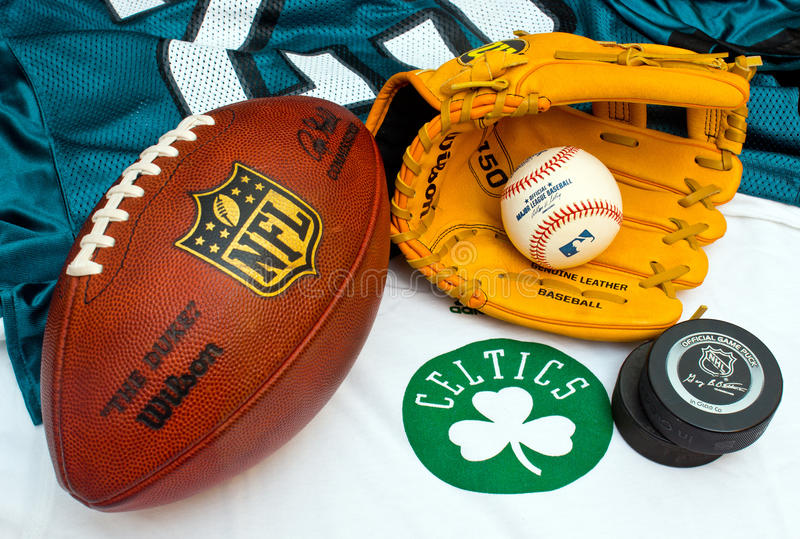 American sport equipment. ZAGREB , CROATIA - SEPTEMBER 17 - american sports equipment, NHL puck, NFL ball, Boston celtics shirt and MLB glove and ball ,product royalty free stock photo