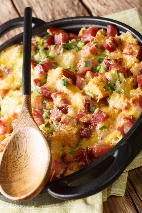 American strata breakfast with ham, onions, cheese and eggs baked in the oven close-up. vertical royalty free stock photos