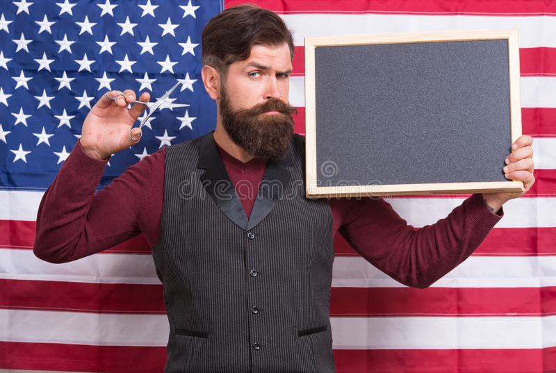American style. American barber hair stylist or hairdresser american flag background. Man with beard and mustache with royalty free stock image