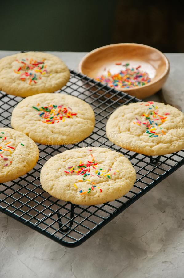 American style round cookies with confetti shortbread on a wir royalty free stock image