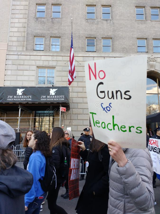 American Teachers, March for Our Lives, Anti Gun Protest, NYC, NY, USA. A demonstrator carries a sign saying, `No Guns for Teachers` during the New York City royalty free stock photography