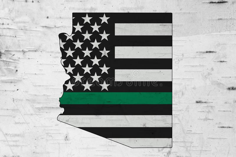American thin green line flag on map of Arizona. For your support of of border patrol and other federal agents royalty free stock photo