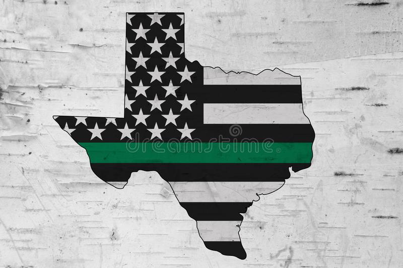 American thin green line flag on map of Texas stock images