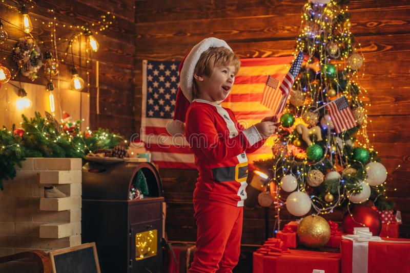 American traditions concept. Toddler celebrate christmas. True american small child cheerful mood waving flag. Kid play. American flag christmas tree. Little stock photos