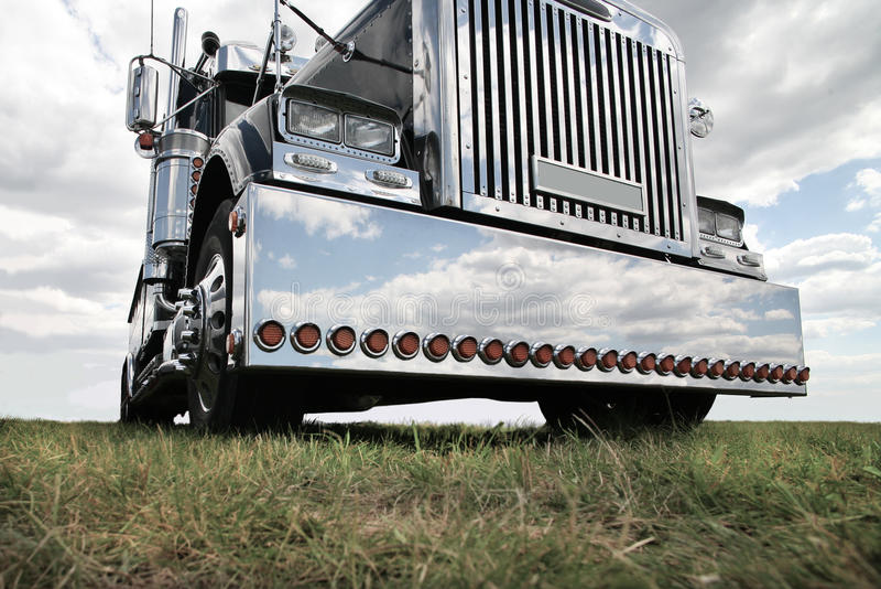 American truck. Big black brilliant American truck in field royalty free stock photos
