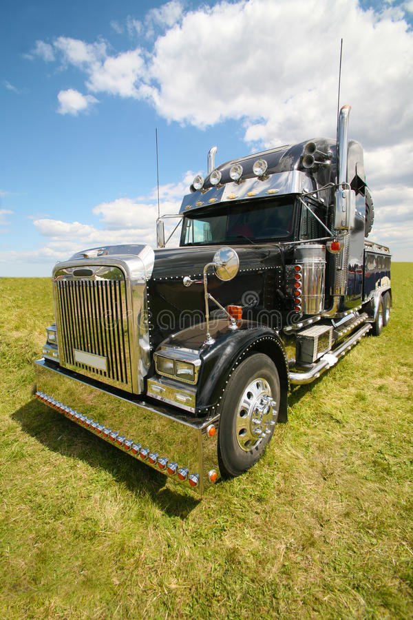 American truck in field. Big black brilliant American truck in field stock image