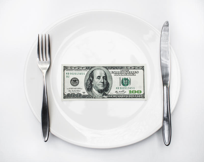 American US dollar on the white plate. Concept is corruption royalty free stock photo